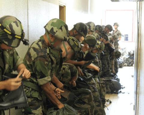 Legionnaires preparing for combat