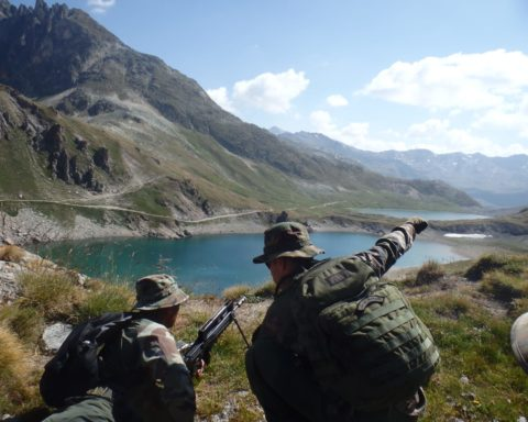 Legionnaire with FAMAS doing shooting training in the alps