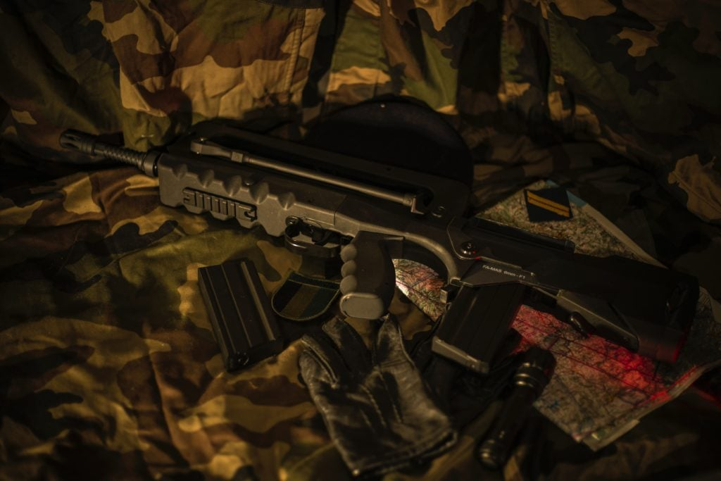 FAMAS Rifle laying on a camouflage coloured jacket
